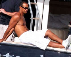 Tiger Woods Relaxes with Man Boobs